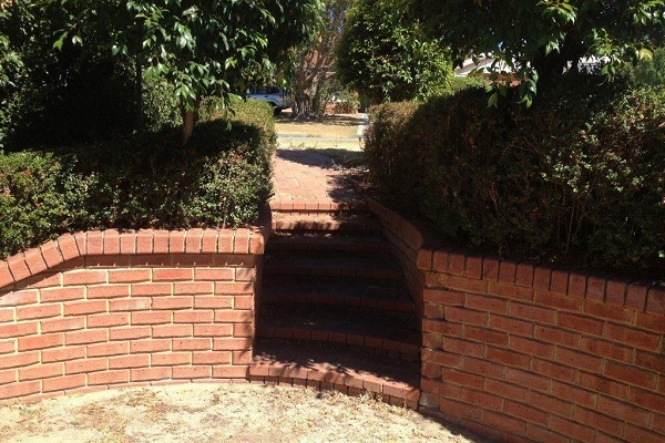 Brick Wall Retaining Wall - Street Outlook Before